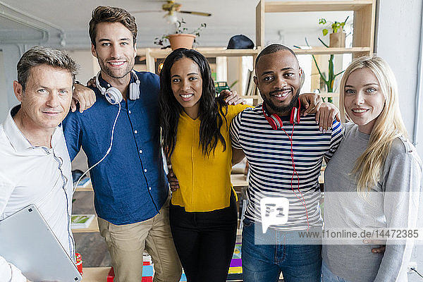 Portrait of confident business team standing in loft office