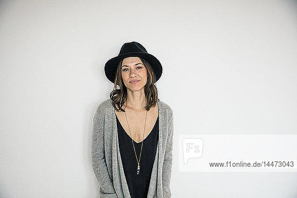 Portrait of a bueaitiful woman  wearing a hat