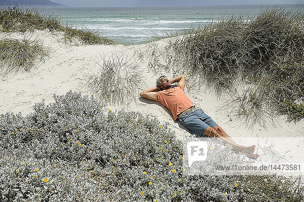 South Africa  man lying at Bloubergstrand