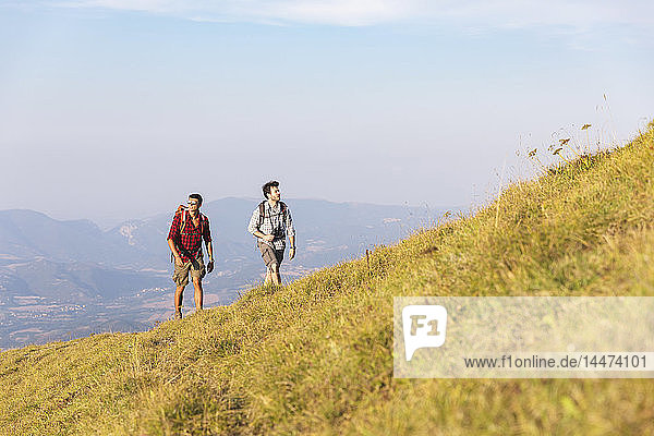 Italy  Monte Nerone  two men hiking in mountains in summer