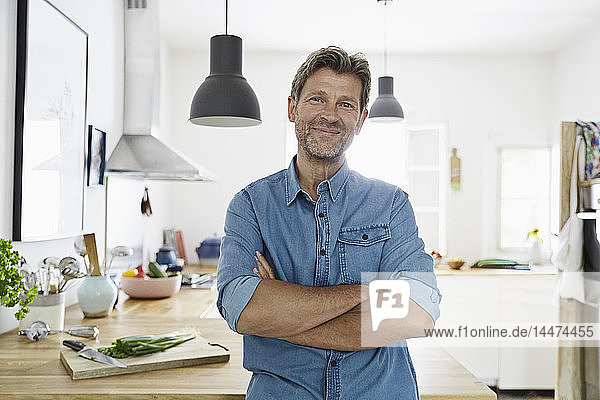 Mature man at home  looking confidet