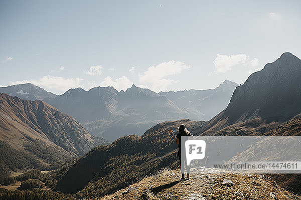 Switzerland  Engadin  woman standing in mountainscape