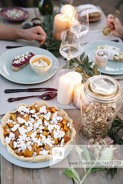Close-up of couple having a romantic candlelight meal outdoors