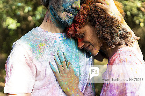 Affectionate couple celebrating Holi  Festival of Colors