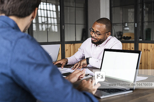 Two businessmen having a meeting in office