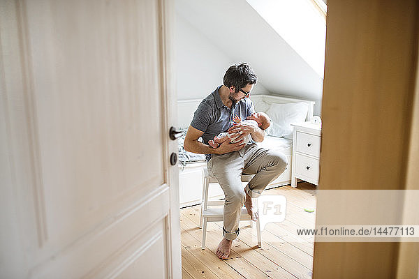 Father at home with his baby daughter