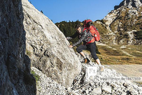 Couple mountain hiking in rocky terrain