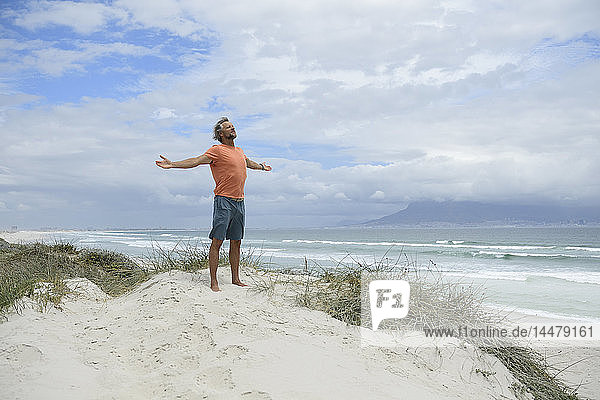 South Africa  man raising arms at Bloubergstrand