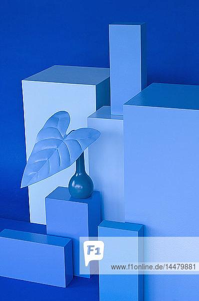 Verschiedene Quader  blaue Vase mit blauem Blatt