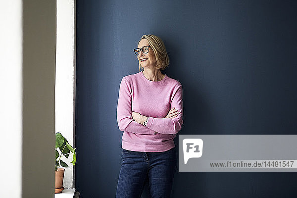 Portait of confident mature woman at home