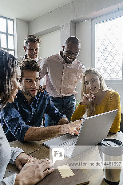 Business team using laptop during a meeting in office
