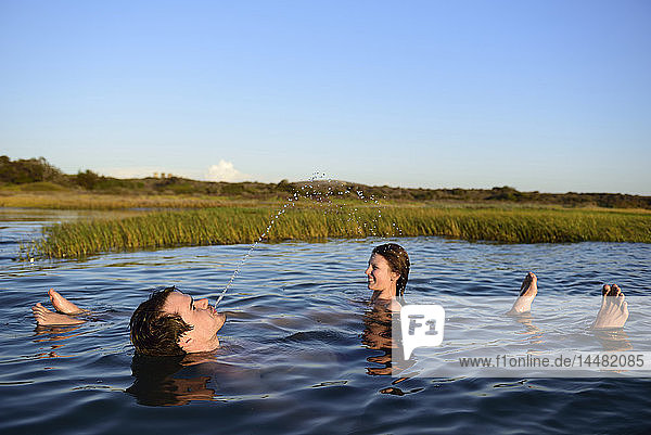 Happy young couple relaxing in water