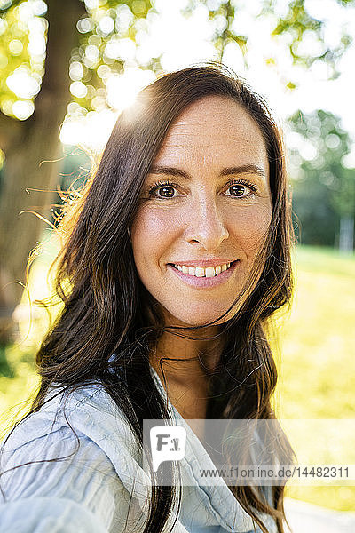 Portrait of smiling mature woman in garden