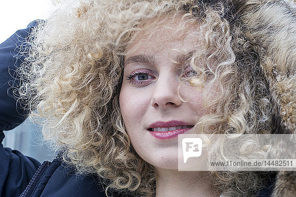 Portrait of blond woman young with ringlets