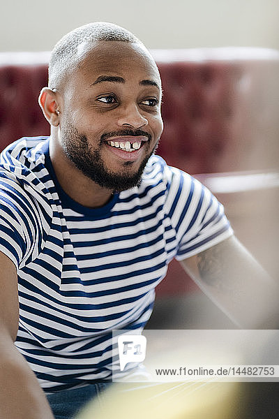 Portrait of smiling young man wearing striped t-shirt