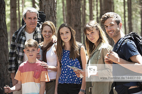 Portrait of a family standing in the forest
