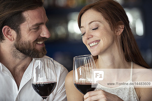 Smiling couple holding wine glass