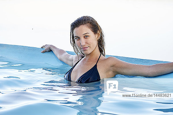 Portrait of young woman in swimming pool