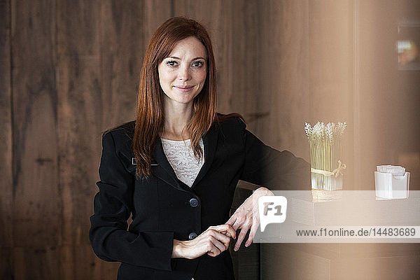 Female receptionist standing in hotel