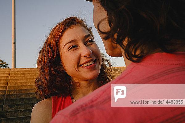 Happy woman looking at boyfriend