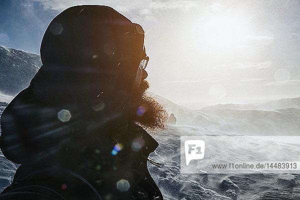 Man looking at snowy landscape  Reykjadalur  Iceland