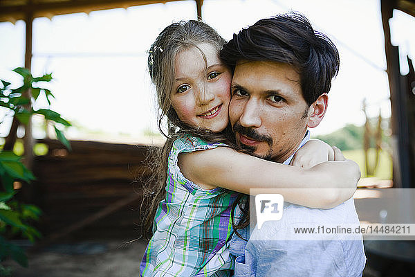 Portrait affectionate father and daughter hugging