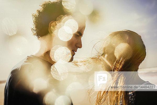 Serene couple on windy  sunny beach