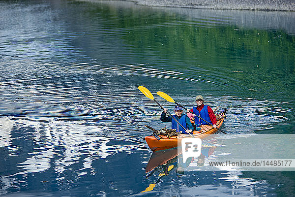 Family sea kayaks in Shoup Bay  Shoup Bay State Marine Park  Prince William Sound  Southcentral Alaska  Summer