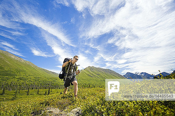 Male hiker on South Fork Eagle River Trail to Eagle Lake in Chugach Mountains Alaska Summer