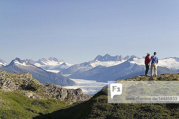 Couple hiking near Mendenhall Glacier Tongass National Forest Alaska Southeast