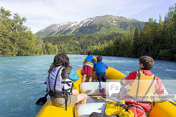 Family & guide river rafting on Kenai River Kenai Peninsula Alaska Summer