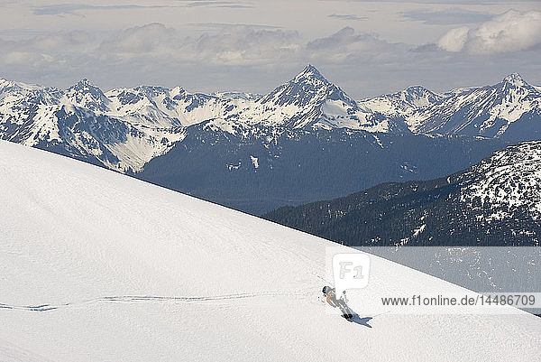 A skier rides the slopes of Mt. Hawthorne while heli-skiing near Juneau  Alaska