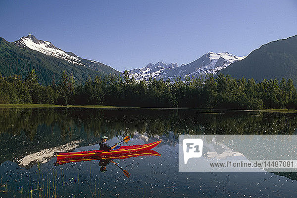 Woman Kayaker in Moose Lake Near Mendenhall Glacier SE AK
