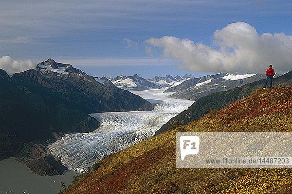 Hiker views Mendenhall Glacier Southeast Alaska Juneau Thunder Mountain Summer