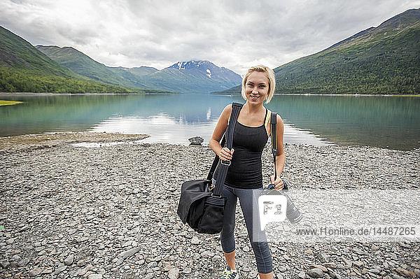 Female photographer at work at Eklutna Lake  Chugach State Park  Southcentral Alaska