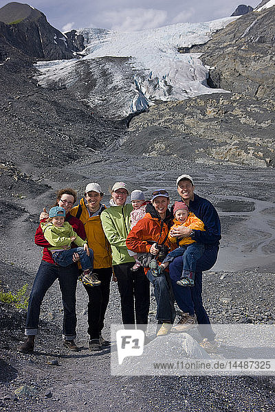 Families posing for a picture on a path in front of the Worthington Glacier  Chugach National Forest  Southcentral  Alaska