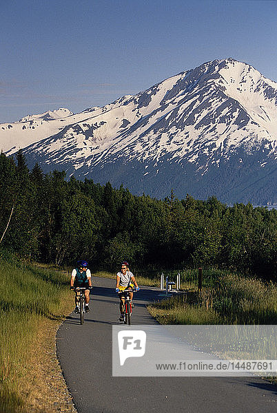 Couple Mountain Biking on Bird-Girdwood Trail SC Alaska