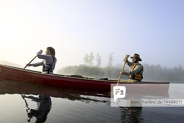 Couple Canoeing @ Sunrise on Lake Portage Valley SC AK Summer in Fog