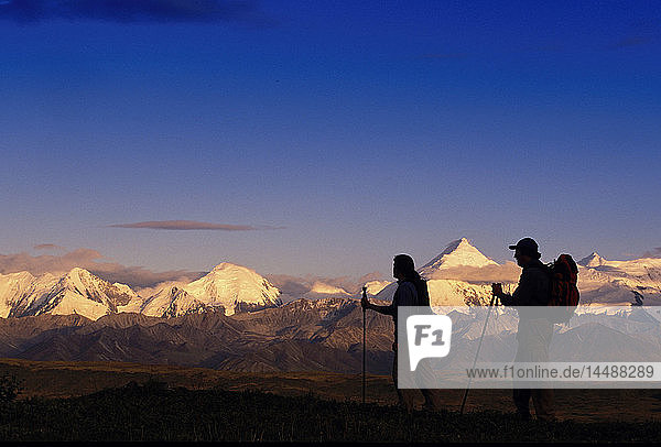 Couple Hiking & Viewing Alaska Range at Sunset DNP