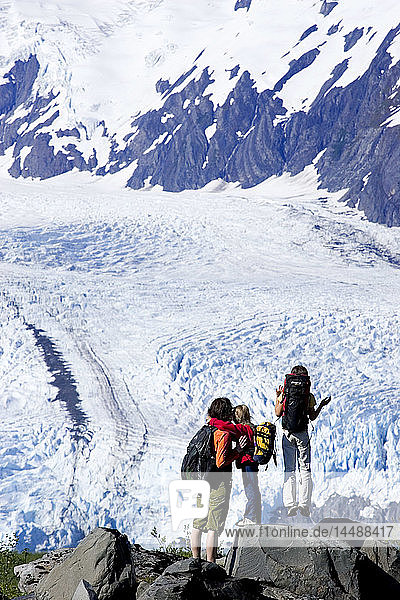 Family on hike over Portage Pass Trail stop to view Portage Glacier Chugach Nat Forest Alaska Summer