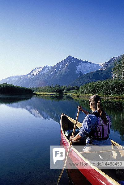 Woman Canoeing in Moose Ponds Near Explorer Glacier