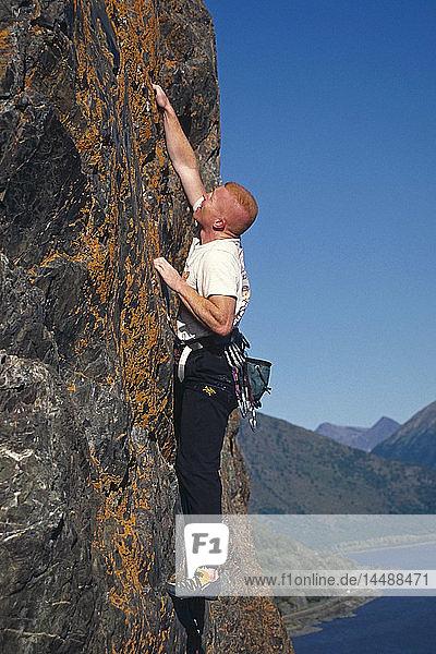 Male rock climbing @ Dino Head Turnagain Arm Chugach Mountains Southcentral Alaska Summer