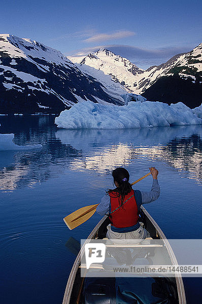 Woman Canoeing on Portage Lake Summer SC Alaska