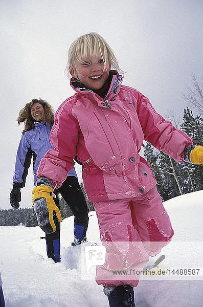 Mother & Daughter Snowshoeing Colorado Winter