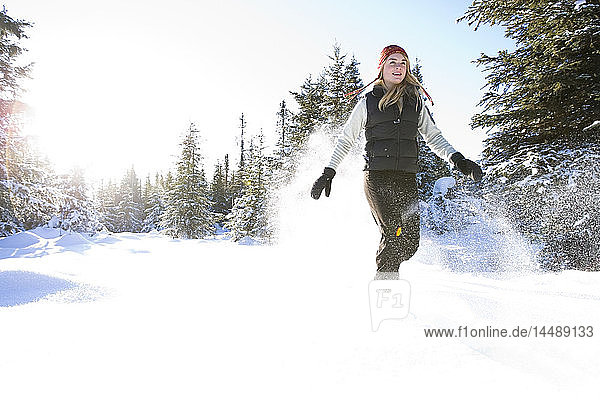 Young woman on snowshoes enjoy the outdoors near Homer  Alaska during winter.