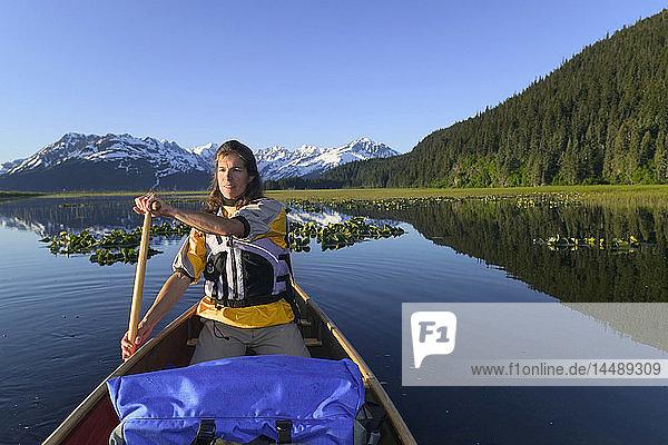 Canoeist @ Wetlands Placer River w/Chugach Mtns SC AK Summer