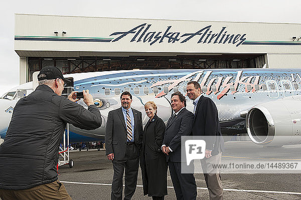 Corporate workers photographed in front of Alaska Airlines´ ''Salmon 30 Salmon'' at Ted Stevens International Airport in Anchorage  Alaska.