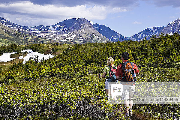 Couple hiking trail below Flat Top Mountain  Glenn Alps area  Chugach State Park  Southcentral Alaska