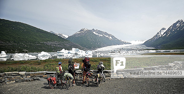 Group of bicyclists on the trail to Spencer Glacier  Chugach National Forest  Kenai Peninsula  Southcentral Alaska  Summer