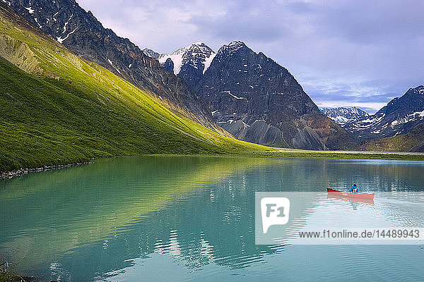 Woman canoeing in portable canoe on Turquoise Lake at Lake Clark National Park  Southcentral Alaska  Summer